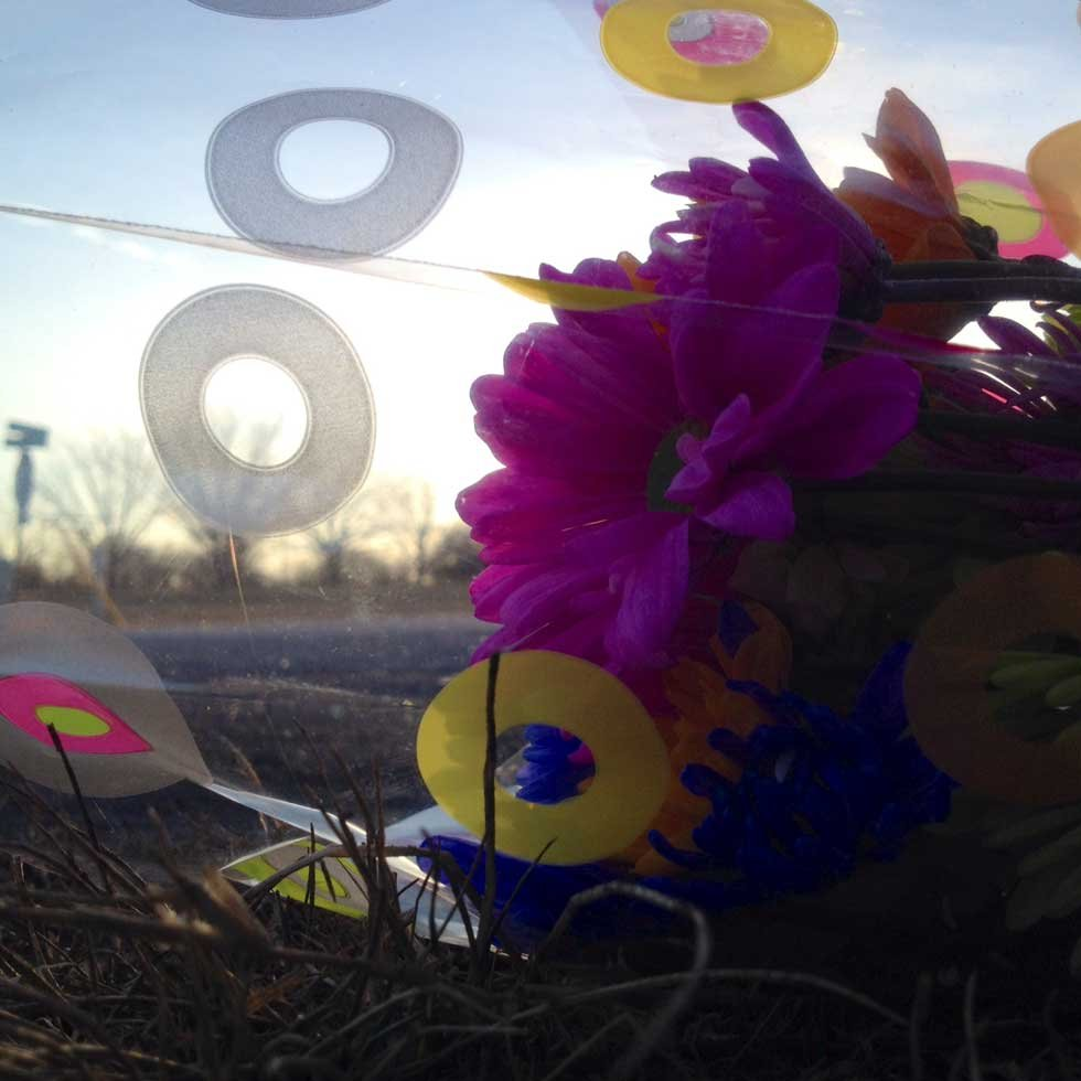 Flowers and a candle were left at the crash scene Tuesday