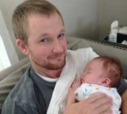 Kyle VanWinkle with newborn son