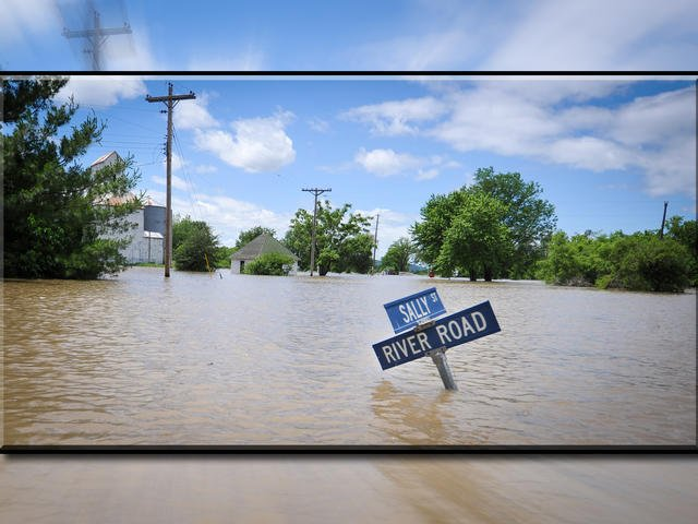 A group of farmers and business owners is suing the U.S. Army Corps of Engineers, claiming the agency mismanaged the Missouri River since 2006 and contributed to major flooding in five states. (AP, File)
