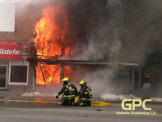 The fire was reported about 12:30 p.m. in Gallatin's square, just east of the courthouse. City officials say it has destroyed a Shelter Insurance and a beauty salon. (Photo courtesy: The North Missourian)
