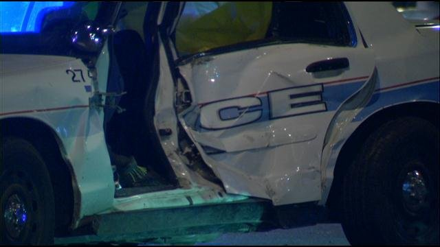 Two Kansas City police officers had to be taken to the hospital after a driver crashed into their cruiser.