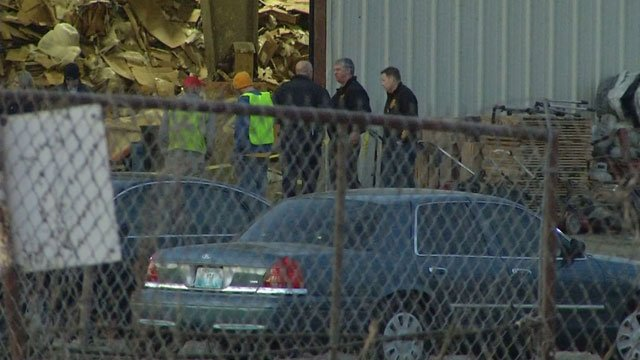 Authorities are investigating after a body was found in trash pile at Kansas City recycling facility on the city's east side.