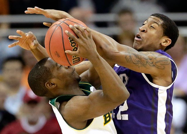 Baylor's Kenny Chery, left, is pressured by TCU's Jarvis Ray during the first half of an NCAA college basketball game in the Big 12 men's tournament on Wednesday, March 12, 2014, in Kansas City, Mo. (AP Photo/Charlie Riedel)