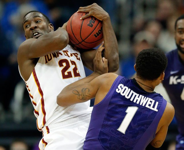 Iowa State forward Dustin Hogue (22) is fouled while rebounding by Kansas State guard Shane Southwell (1) in the quarterfinals of the Big 12 Conference men's tournament in Kansas City. (AP Photo/Orlin Wagner)