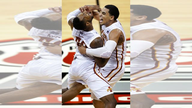 Iowa State guards DeAndre Kane, left, and Naz Long, right, celebrate following an NCAA college basketball game in the final of the Big 12 Conference men's tournament in Kansas City, Mo., Saturday, March 15, 2014. (AP Photo/Orlin Wagner)