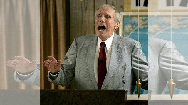 FILE - In this March 19, 2006 file photo, Rev. Fred Phelps Sr. preaches at his Westboro Baptist Church in Topeka, Kansas. (AP Photo/Charlie Riedel, File)