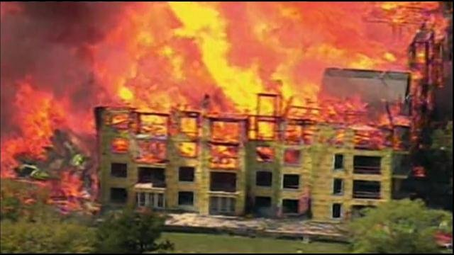 Gusty winds turned what had been a small rooftop fire into a massive blaze that destroyed a large apartment complex under construction near downtown Houston, authorities said.