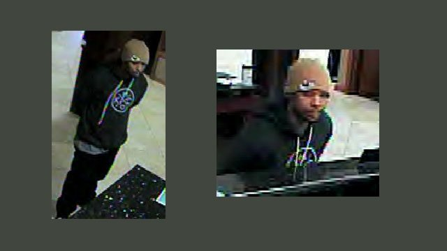 Lawrence police say they've arrested a man accused of robbing a credit union and making his getaway to Nebraska in a waiting taxi.