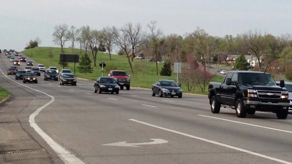 The four occupants of the minivan told officers they were headed southbound on Highway 71 and were stopped at a red light at 59th Street when they heard what sounded like two gunshots.