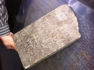 Leavenworth residents are working to return an old tombstone found recently during a spring cleaning project.