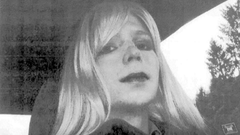 In this undated photo, Bradley Manning dons a wig and makeup.