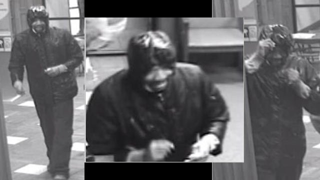 Surveillance photos of Bank Midwest robber.