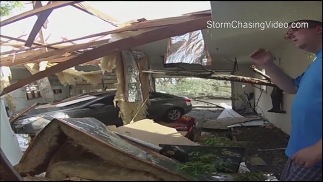 The National Weather Service said the tornado was part of a super cell storm that formed over the Kansas City metropolitan area earlier Saturday and continued eastward, spawning at least one more tornado that also struck near the town of Marshall.