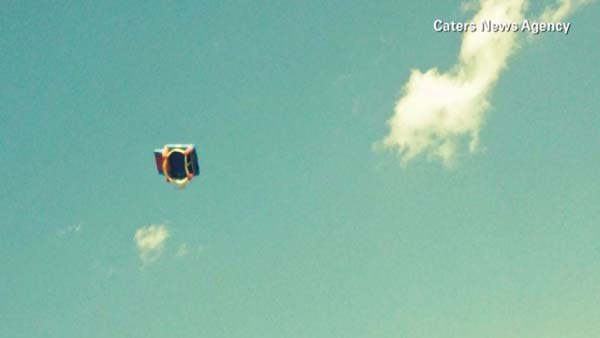 The bounce house could be seen at least 50 feet in the air. (Source: Caters News Agency/CNN)
