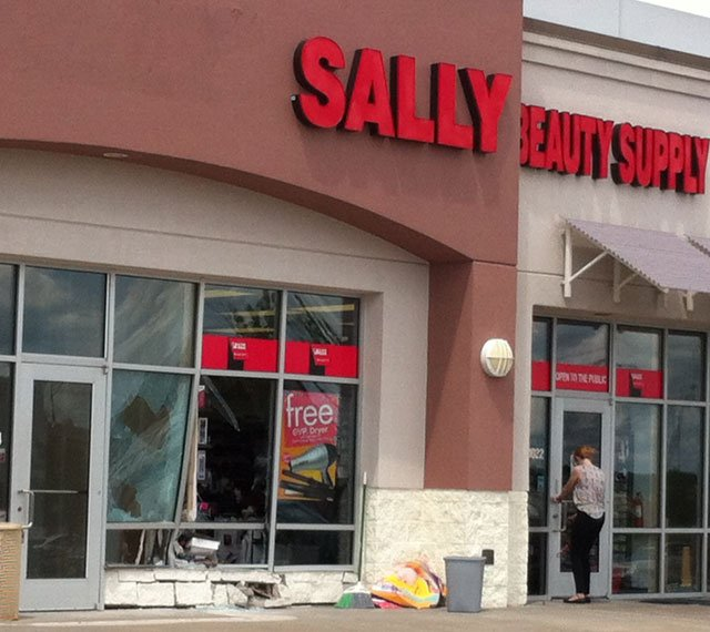 Kansas City police said the car was initially parked in front of Sally Beauty Supply, located at 1022 W. 136th St., when it struck the building. (Grady Reid/KCTV5 News)