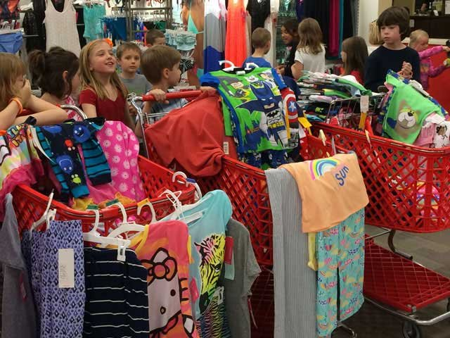 Jasmin Boothe has raised more than $4,000 and have bought thousands of pajamas to hand to children battling cancer.