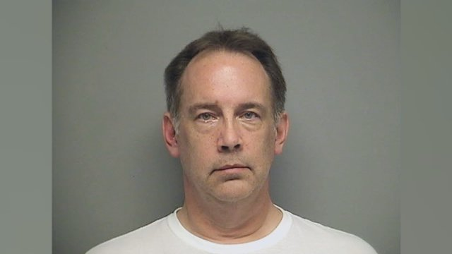 Steven Zelich, a 52-year-old security officer, was charged Thursday with two counts of hiding a corpse.