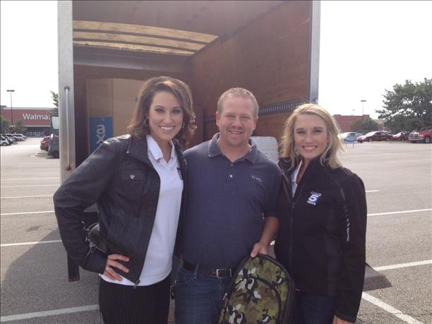 KCTV5's Lisa Teachman and Courtenay DeHoff with someone who stopped by to donate a backpack.