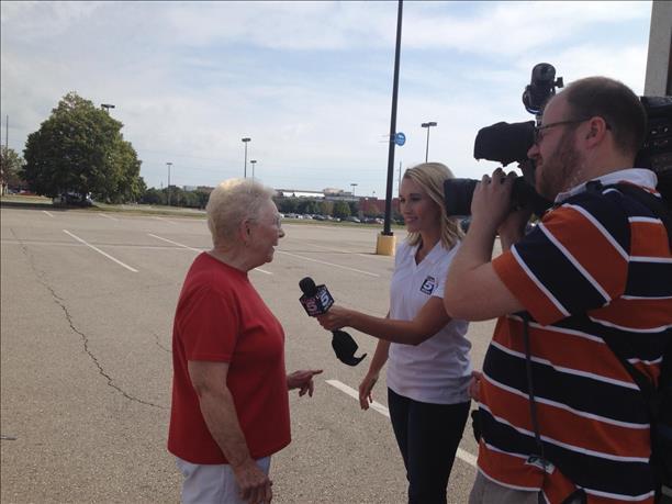 KCTV5's Courtenay DeHoff interviews a Salvation Army volunteer.