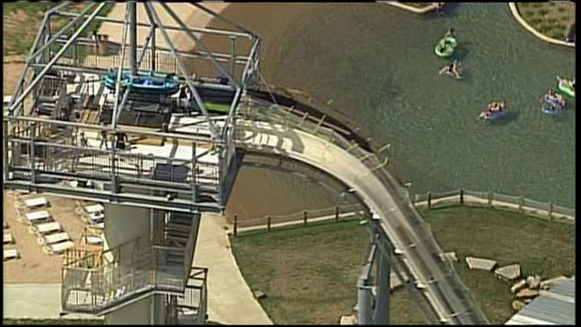 Early riders on the world's tallest water slide say the Kansas City, Kansas, attraction is as scary as it looks, but they couldn't wait to go down it again.