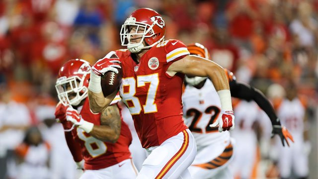 Kansas City Chiefs tight end Travis Kelce (87) runs for a touchdown reception in the first half of an NFL preseason football game against the Cincinnati Bengals Thursday, Aug. 7, 2014, in Kansas City, Mo. (AP Photo/Ed Zurga)