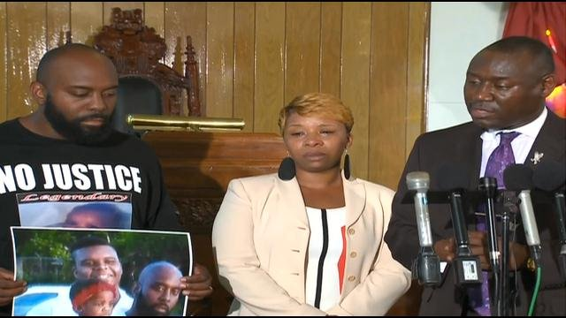 Attorney Benjamin Crump (right) and parents of Michael Brown who was killed by St. Louis area police.