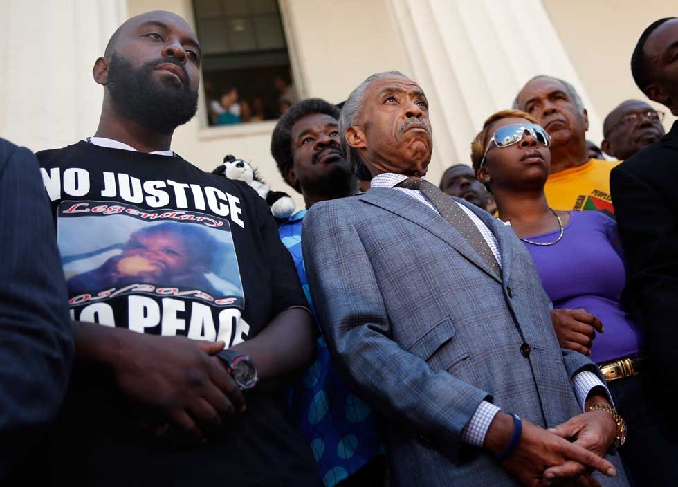 Al Sharpton (center) stands with Michael Brown and Lesley McSpadden, parents of unarmed teen killed during struggle with police