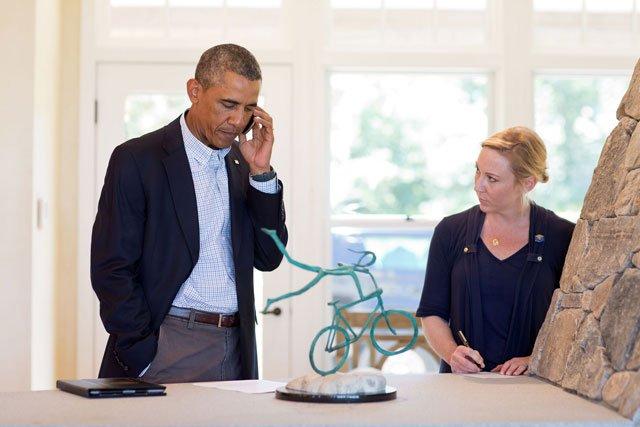 President Barack Obama talks on the phone with Missouri Gov. Jay Nixon about the situation in Ferguson, Mo., in Chilmark, Martha's Vineyard, Mass., August 14, 2014. Deputy Chief of Staff Anita Breckenridge is at right. (Pete Souza/White House)