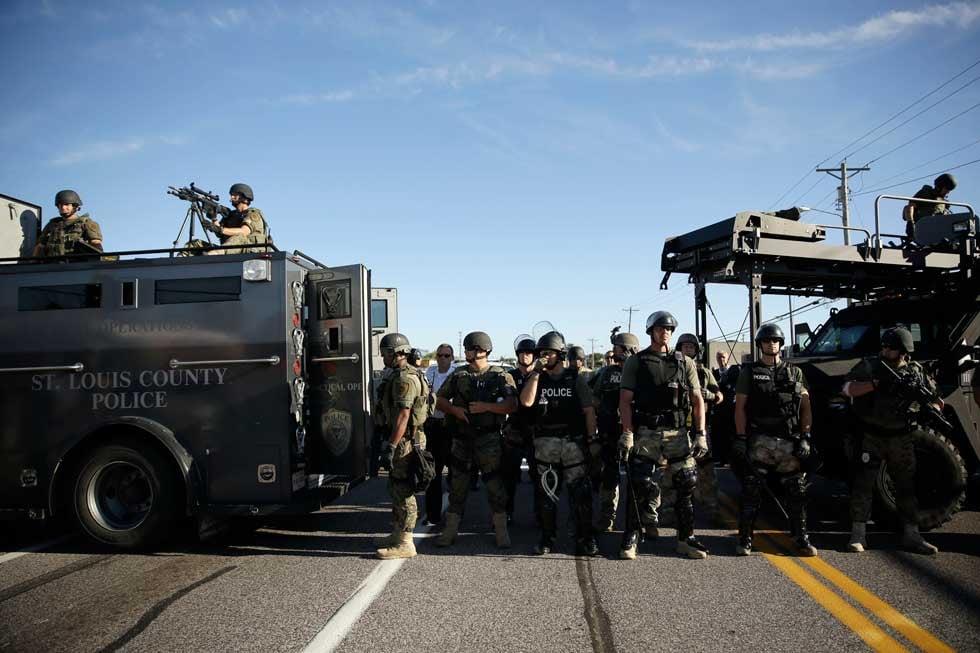 Police in riot gear on Wednesday in Ferguson (AP)