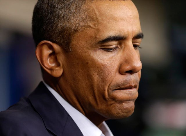 Taking a two-day break from summer vacation, President Barack Obama met with top advisers at the White House Monday to review developments in racially charged Ferguson, MO. (AP Photo/Pablo Martinez Monsivais)