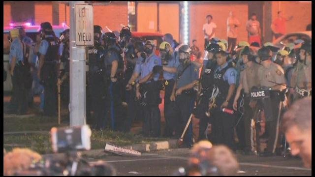 Police in Ferguson, MO began to advance on the remaining protesters late Monday night in Ferguson, MO. (Source: CNN)