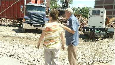 Shiela Alcorn and her father Charles Little watch the final demolition of the Rios De Agua Viva Church. Little was a pastor there from 1972 to 1987.
