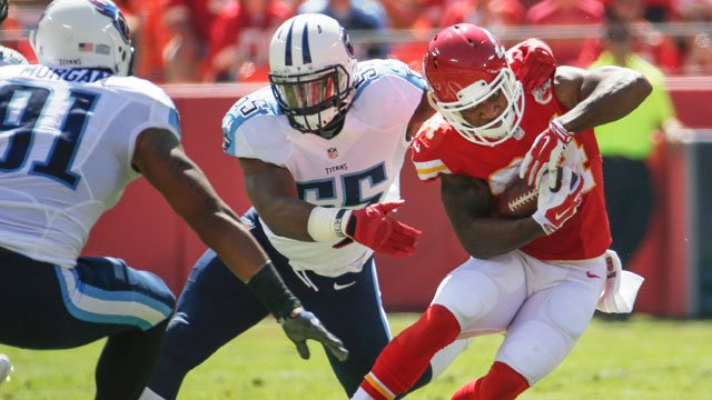 Kansas City Chiefs running back Knile Davis (34) is tackled by Tennessee Titans linebacker Zach Brown (55) in the first half of an NFL football game in Kansas City, Mo., Sunday, Sept. 7, 2014. (AP Photo/Charlie Riedel)