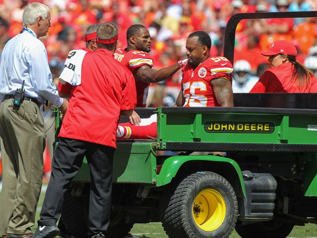 Injured Kansas City Chiefs linebacker Derrick Johnson (56) is consoled by cornerback Chris Owens (20) in the first half of an NFL football game against Tennessee Titans in Kansas City, Mo., Sunday, Sept. 7, 2014. (AP Photo/Ed Zurga)