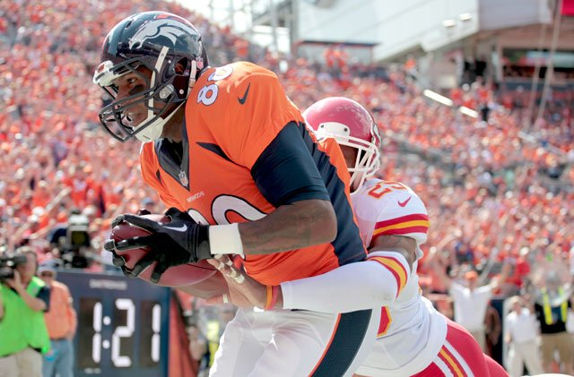 Denver Broncos tight end Julius Thomas (80) pulls in a touchdown pass as Kansas City Chiefs strong safety Eric Berry (29)defends during an NFL preseason football game, Sunday, Sept. 14, 2014, in Denver. (AP Photo/Joe Mahoney)