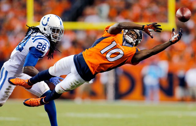 Denver Broncos wide receiver Emmanuel Sanders (10) can't make the catch as Indianapolis Colts cornerback Greg Toler (28) defends during the second half of an NFL football game, Sunday, Sept. 7, 2014, in Denver. (AP Photo/Joe Mahoney)