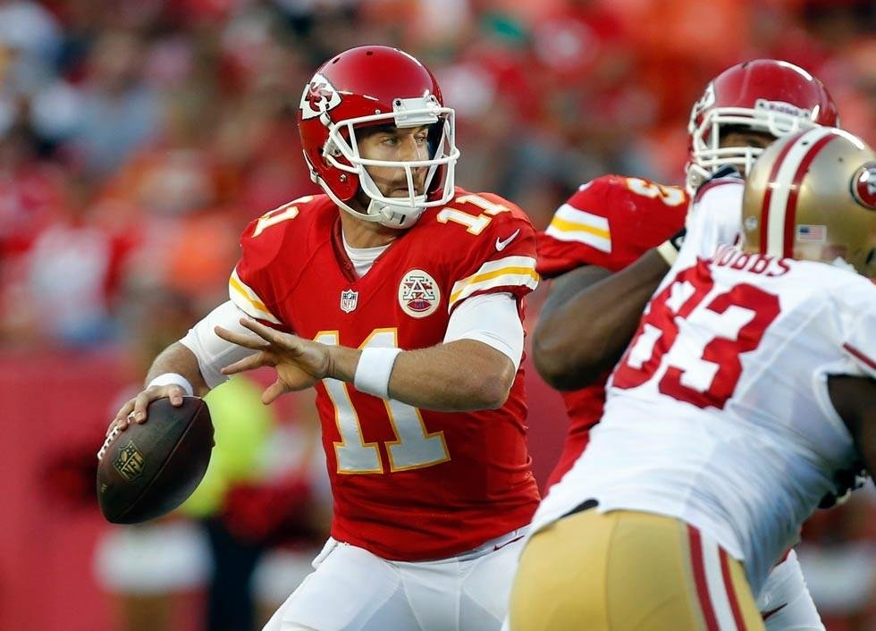 Kansas City Chiefs quarterback Alex Smith (11) passes to a teammate during the first half of an preseason NFL football game against the San Francisco 49ers at Arrowhead Stadium in Kansas City, Mo., Friday. (AP Photo/Ed Zurga)