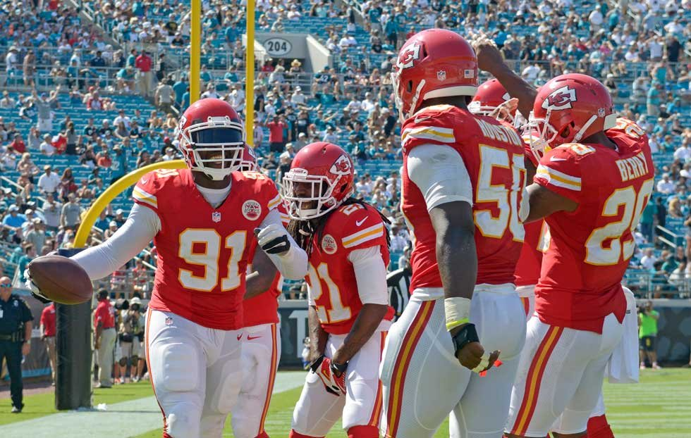 Tamba Hali celebrates after running back interception for touchdown in game against Jaguars (AP)