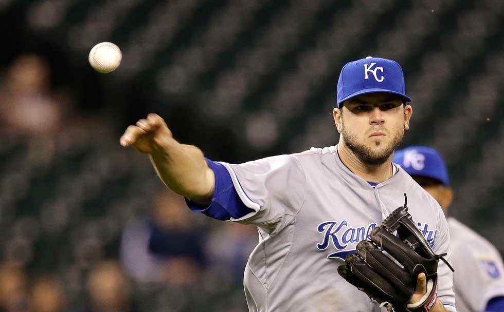Mike Moustakas is staying with the Kansas City Royals in a surprising turn dictated by a historically slow free-agent market. (AP File Photo)