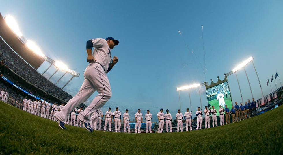 Kansas City Royals' Billy Butler is introduced before the AL wild-card playoff baseball game against the Oakland Athletics Tuesday, Sept. 30, 2014, in Kansas City, Mo. (AP Photo/Charlie Riedel)