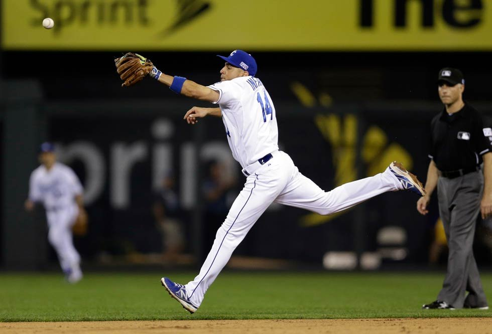A ball hit by Oakland Athletics' Josh Reddick bounces off the glove of Kansas City Royals second baseman Omar Infante for a single during the seventh inning of the AL wild-card playoff baseball game Tuesday in Kansas City, MO. (AP Photo/Jeff Roberson)
