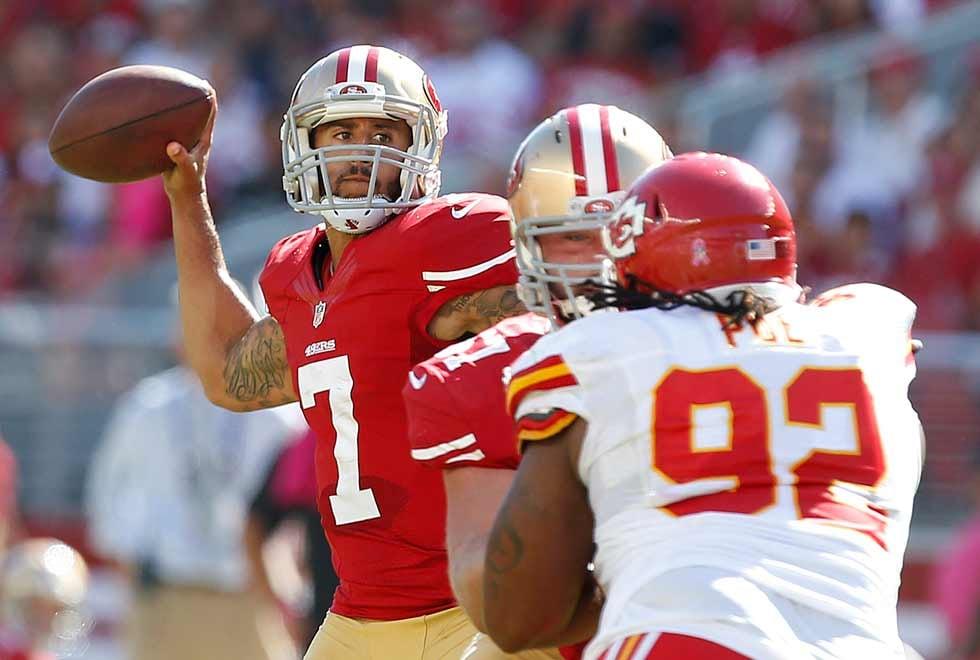 San Francisco 49ers quarterback Colin Kaepernick (7) passes against the Kansas City Chiefs during the second quarter of an NFL football game in Santa Clara, Calif., Sunday, Oct. 5, 2014. (AP Photo/Tony Avelar)