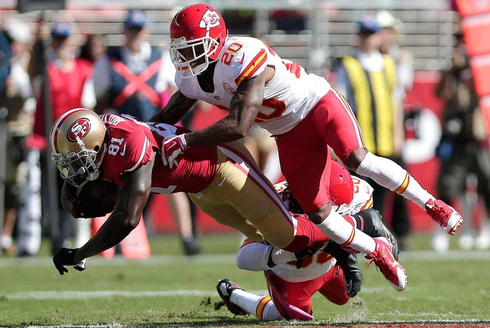 San Francisco 49ers wide receiver Anquan Boldin (81) is tackled by Kansas City Chiefs cornerback Chris Owens (20) and defensive back Ron Parker during the second quarter of an NFL football game in Santa Clara, Calif., Sunday (AP Photo/Marcio Jose Sanchez)