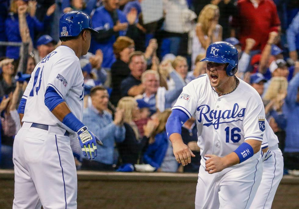 Royals designated hitter Billy Butler (16) celebrates with Kansas City Royals catcher Salvador Perez (13) after Butler scored on a 3-RBI double by Alex Gordon during the first inning of Game 3 of baseball's AL Division Series against the Angels
