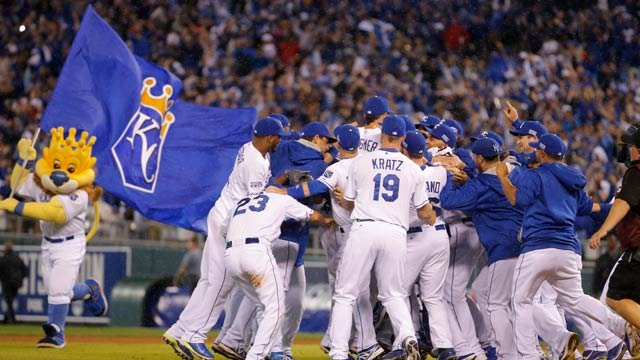 Kansas City Royals players celebrate following Game 3 of baseball's AL Division Series in Kansas City, Mo., Sunday, Oct. 5, 2014. The Kansas City Royals defeated the Los Angeles Angels 8-3 to sweep the series. (AP Photo/Travis Heying)