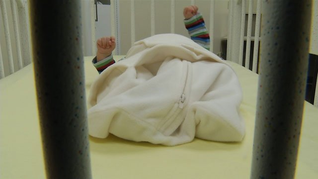 Experts say babies should sleep on their backs in a sleep sack - no loose blankets or nothing with any ties or strings.