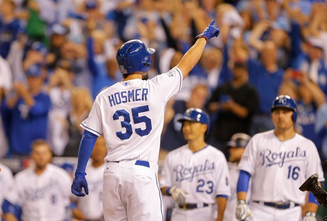Kansas City Royals first baseman Eric Hosmer (35) celebrates his two-run home run against the Los Angeles Angels during the third inning of Game 3 of baseball's AL Division Series in Kansas City, Mo., Sunday, Oct. 5, 2014. (AP Photo/Travis Heying)