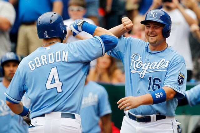 Kansas City Royals' Alex Gordon is congratulated by teammate Billy Butler after hitting a two-run home run in the first inning against the San Francisco Giants at Kauffman Stadium in Kansas City on Aug. 10, 2014. (AP Photo/Colin E. Braley)