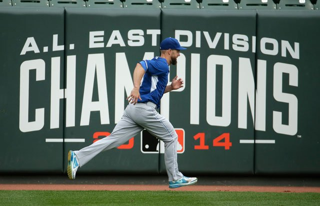 Kansas City Royals left fielder Alex Gordon runs during practice for American League baseball championship series Thursday, Oct. 9, 2014, in Baltimore. The Royals will play the Baltimore Orioles starting Friday. (AP Photo/Charlie Riedel)