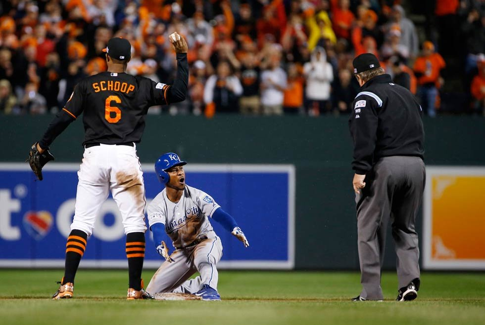Kansas City Royals' Jarrod Dyson (1) reacts after being caught steeling during seventh inning of Game 1 of the American League baseball championship series against the Baltimore Orioles Friday, Oct. 10, 2014, in Baltimore. (AP Photo/Matt Slocum)